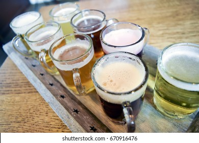 Belgian beer flight on wooden table in bar