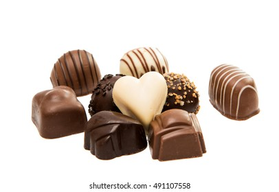 Belgian chocolate candies isolated on white background