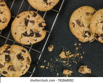 Belgian Dark Chocolate Chip Cookies Biscuits Against a Black Background