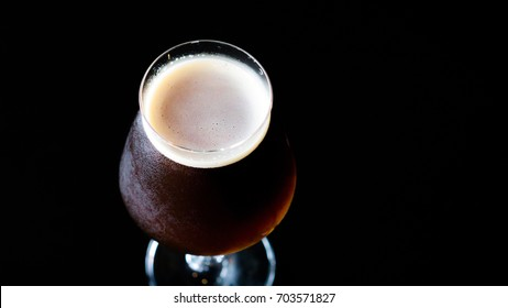 Belgian dubbel beer , dubbel is a belgian trappist beer. Rich malty ,mild alcoholic ,dark fruit aromas, dark amber color.
