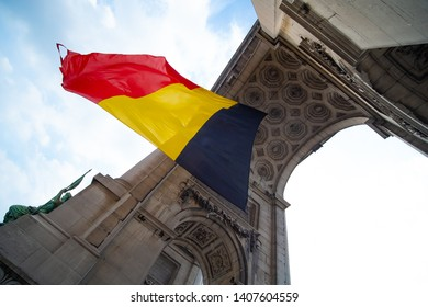 Belgian flag blowing in the middle of an arch