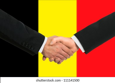The Belgian flag and business handshake