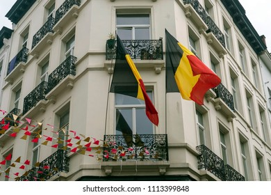The Belgian flag on the building. Holiday, architecture of Brussels