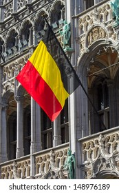 belgian flag on the grand place  Broodhuis in brussels