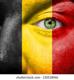 Belgian flag painted on mans face to support his country Belgium