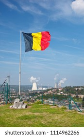 Belgian flag with view over Huy from the Fort to the distant nuclear power station in Tihange, Belgium.