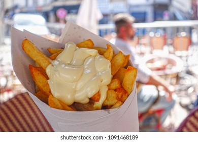 Belgian french fries with mayonnaise served in a paper cone