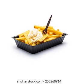 Belgian fries with mayonnaise and fork isolated on white background