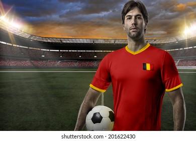 belgian soccer player, celebrating on a stadium.