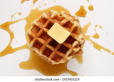 Belgian waffle with butter and messy syrup.
