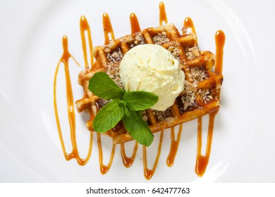 Belgian waffle with ice cream, caramel and mint.