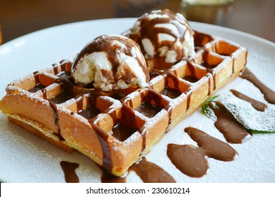 Belgian waffle with ice cream, chocolate and mint