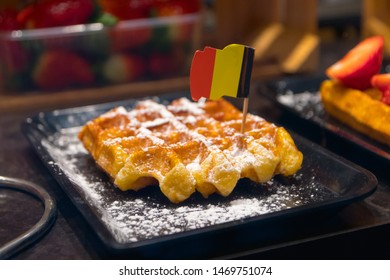 Belgian Waffle with icing sugar and a Belgium flag