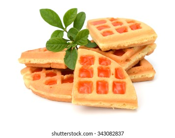 Belgian waffles with caramel sauce isolated on white background (top view)