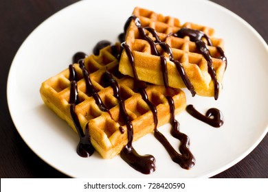 Belgian waffles with chocolate on a plate