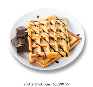 Belgian waffles with chocolate on white isolated background