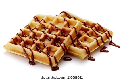 Belgian waffles with chocolate sauce isolated on white background
