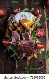 Belgian waffles with egg, arugula, tomatoes and dried meat