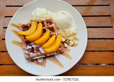 Belgian waffles with fresh peaches, Ice cream, Whip Cream and crumble.