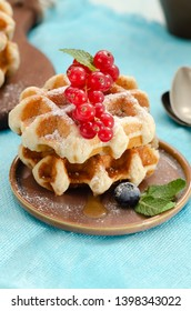 Belgian waffles with honey caramel sauce and summer berries