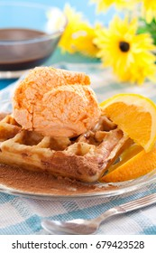 Belgian waffles with icecream and orange