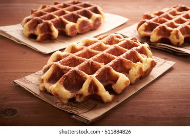 Belgian waffles on a brown wooden table
