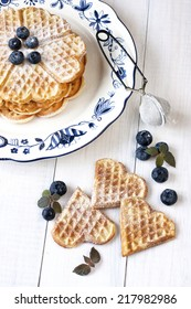 Belgian waffles on white plate