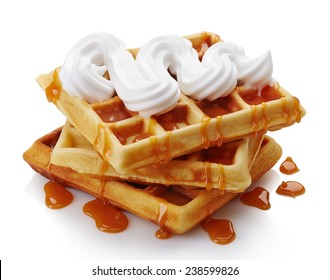 Belgian waffles with whipped cream and caramel sauce  isolated on white background
