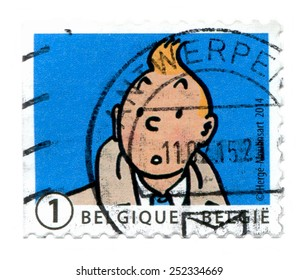 BELGIUM, 22 APRIL 2014: A Used Belgian Postage Stamp, depicting the iconic comic book character TInTin. Created in 1929 by Herge, Tintin has been adapted for radio, television, theatre, and film.