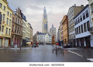 Belgium. Antwerp. The view of The Antwerp Cathedral from the street. Away 123-meter tower of the Antwerp Cathedral. It is a Roman Catholic parish Church.