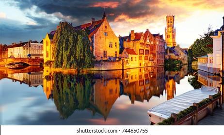 Belgium - Bruges,  Rozenhoedkaai with Perez de Malvenda house and Belfort van Brugge at sunset