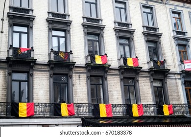 Belgium, Brussels- February 4, 2017: hanging Belgian flags on balcony