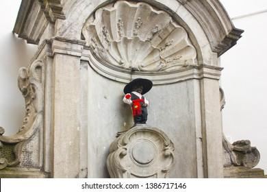 BELGIUM, BRUSSELS - May 1, 2019: Manneken Pis Statue in portuguese costume in Brussels