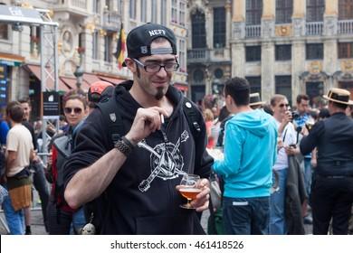 BELGIUM, BRUSSELS - SEPTEMBER 07, 2014: Belgian Beer Weekend 2014. The most famous beer festival in Belgium. The man at the festival.