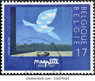 "BELGIUM - CIRCA 1998: A stamp printed in Belgium shows the painting ""Le retour"" by Magritte, circa 1998"