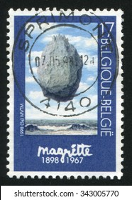 BELGIUM - CIRCA 1998: stamp printed by Belgium, shows Castle of  the Pyranees, by Rene Magritte, circa 1998