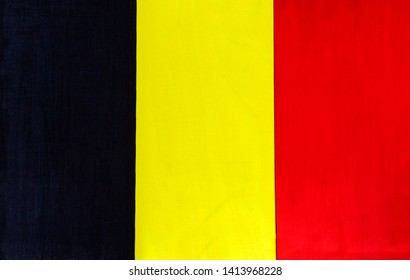 Belgium flag - Belgium's national flag colors on a wooden background.