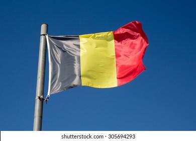 Belgium flag under blue sky