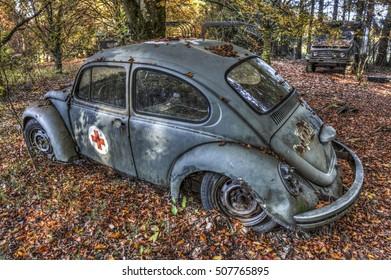 BELGIUM - OCTOBER 31: Abandoned red cross VW Beetle on October 31, 2016 somewhere in Belgium