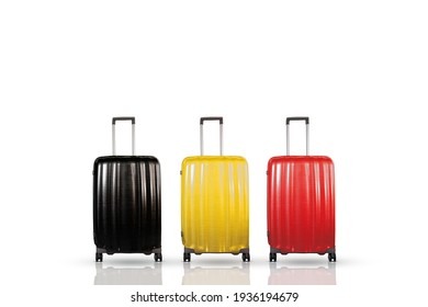 Belgium travel and holidays concept. Three travel suitcases with black, yellow and red colors that representing the Belgian national flag. Suitcases isolated on white.