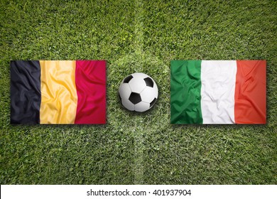 Belgium vs. Italy flags on green soccer field