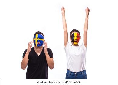 Belgium vs Sweden. Football fans of national teams demonstrate emotions: Belgium win, Sweden lose. European football fans concept.