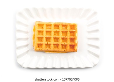 Belgium waffer on white ceramic plate isolated on white background. Fresh baked wafer top view.