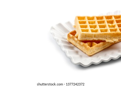 Belgium waffers on white ceramic plate isolated on white background. Fresh baked wafer with copy space.