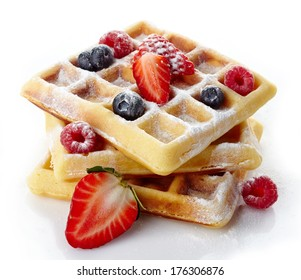 Belgium waffles with fresh berries and caster sugar isolated on white background