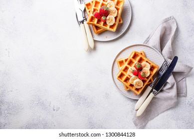 Belgium waffles with strawberries and banana