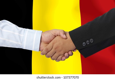 Belgium,businessmen handshake