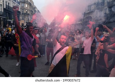 Belgium's supporters cheer amid red flare smoke after  the match of UEFA EURO 2020 between Denmark and Belgium in Brussels, Belgium on June 17, 2021.