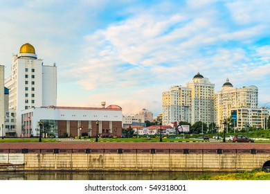 """BELGOROD, RUSSIA - JULY 04, 2016: City embankment of river Vezelka. Campus of Belgorod State University. Detail of main building university with observatory and residential complex """"Slavic""""."""
