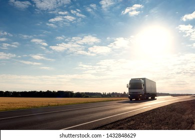 Belgorod , Russia - JUN 17, 2019: Truck driving on the asphalt road rural landscape.